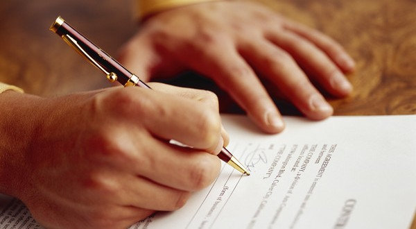 Man Signing Contract