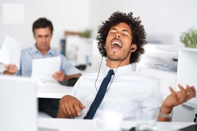 Business man listening to music at work